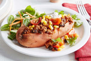 Baked Potatoes Topped with Spicy Vegetable Stew