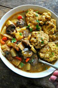 Vegan Winter Vegetable Stew with Cheesy Herb Dumplings