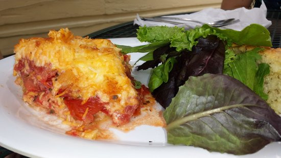 Tomato Pie Cafe  Tomato pie with a side of greens