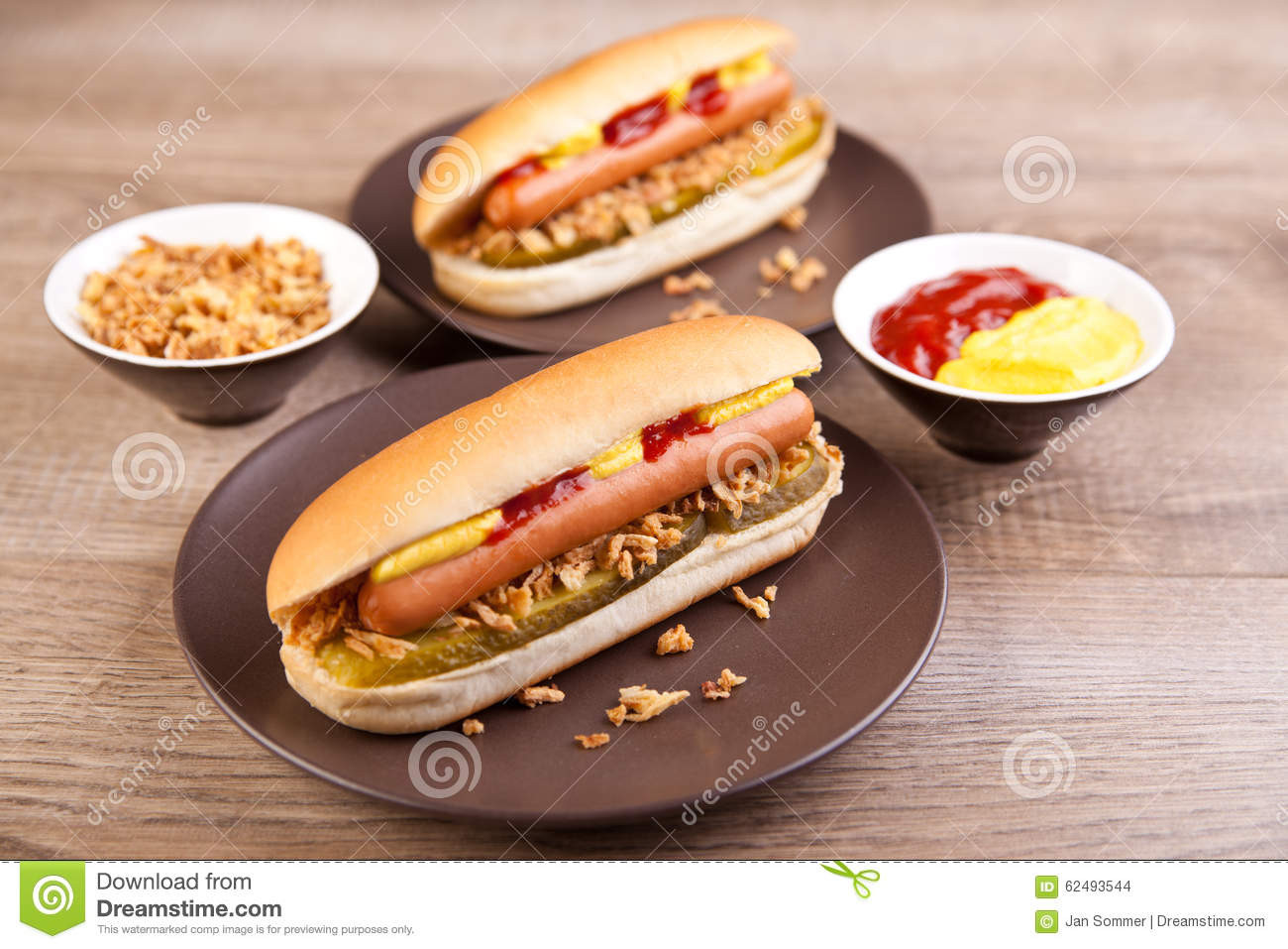 Two Hot Dogs  Two Hot Dogs With Gherkin And ions Stock Image