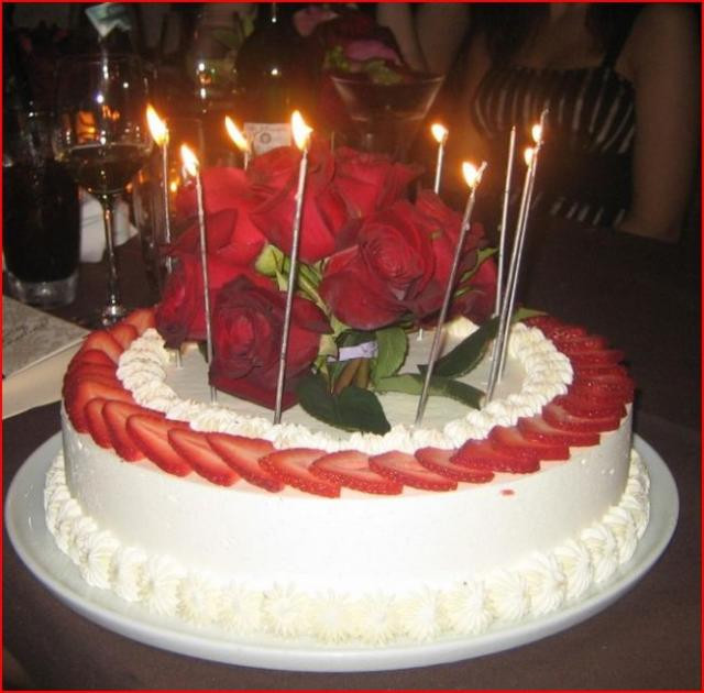 When Did Adding Candles To The Birthday Cake Originated  Strawberry and cream birthday cake with real red roses on