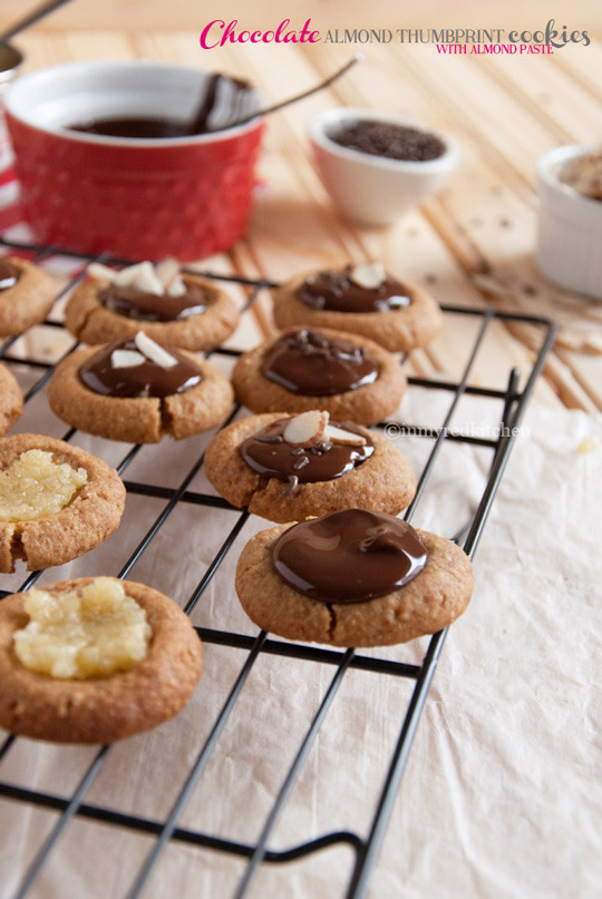Almond Thumbprint Cookies  Chocolate almond thumbprint cookies with almond paste