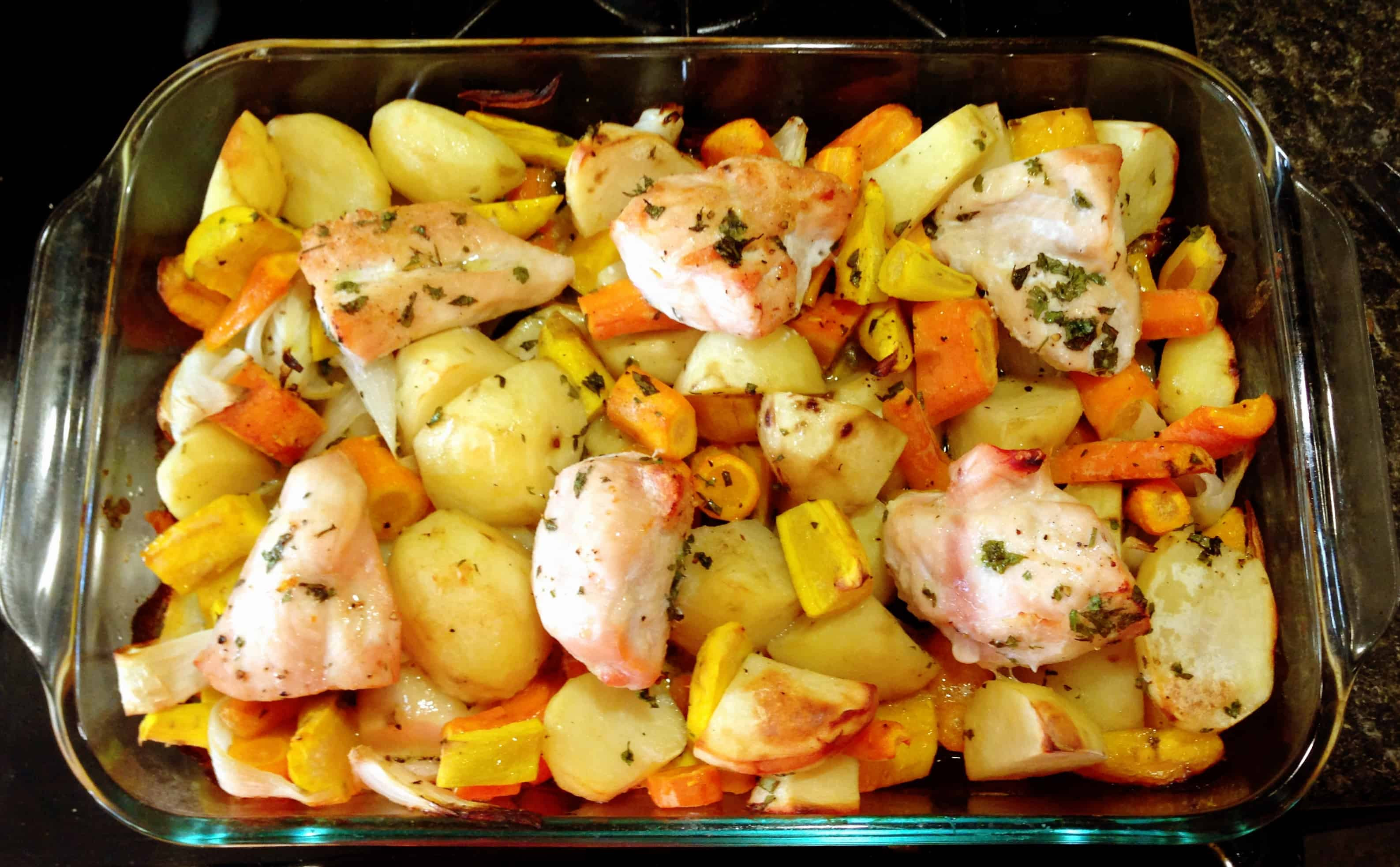 Baked Chicken And Potatoes  Baked chicken potatoes carrots and herbs from the