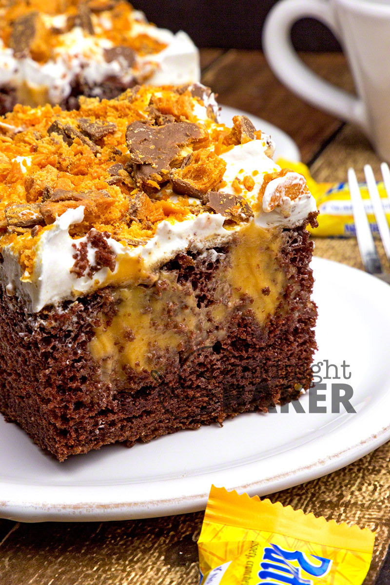Butterfinger Poke Cake  Chocolate Butterfinger Poke Cake The Midnight Baker