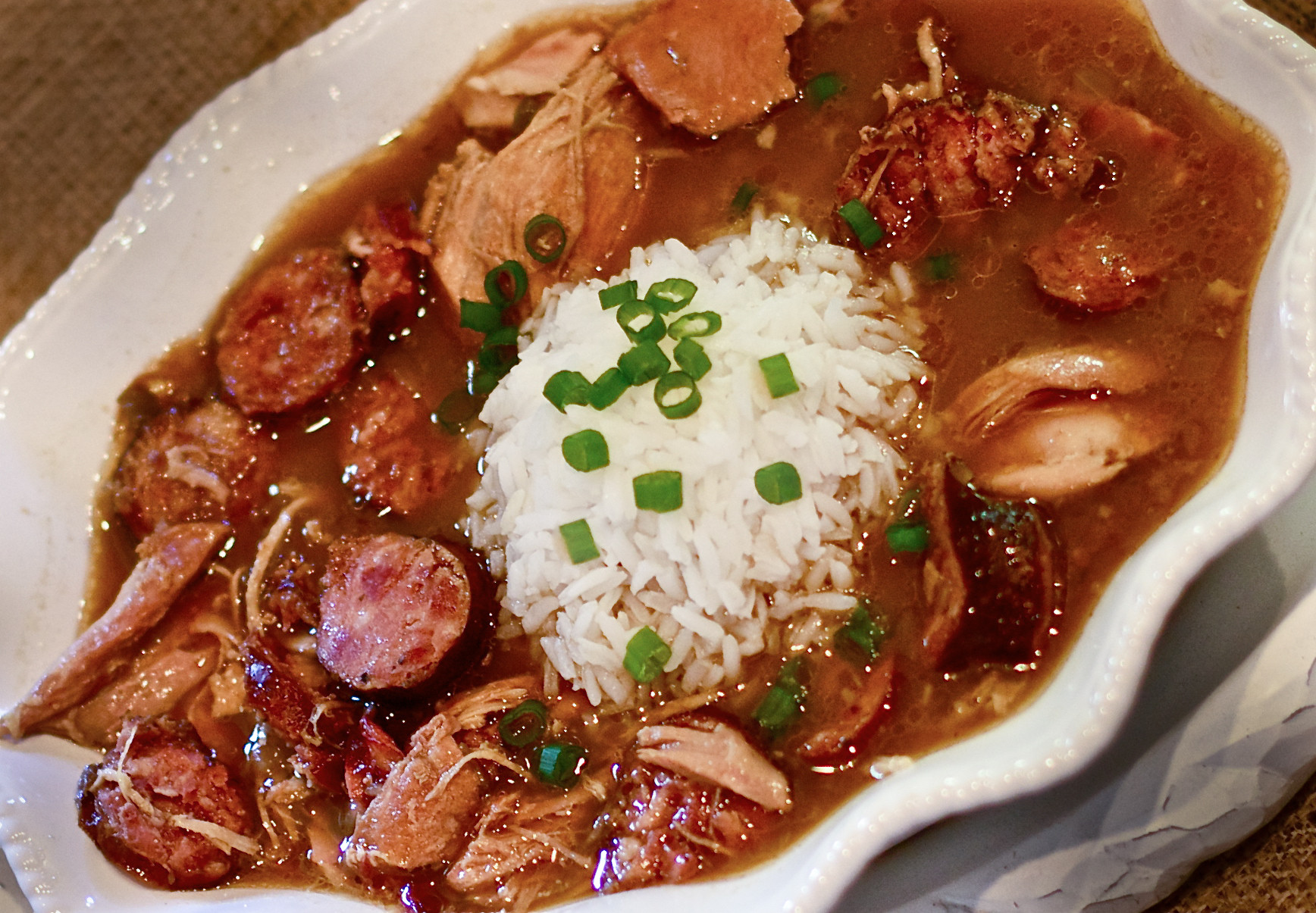 Chicken And Sausage Gumbo  Chicken and Smoked Sausage Gumbo is a deep dark Cajun dish