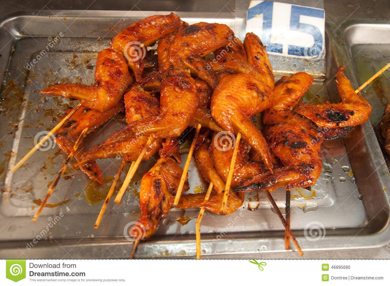 Chicken Wings On Sale  Roast Chickens Wings Tray For Sale Stock Image