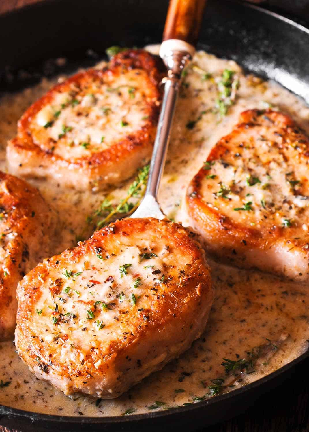 Cooking Pork Chops  Boneless Pork Chops in Creamy Garlic and Herb Wine Sauce