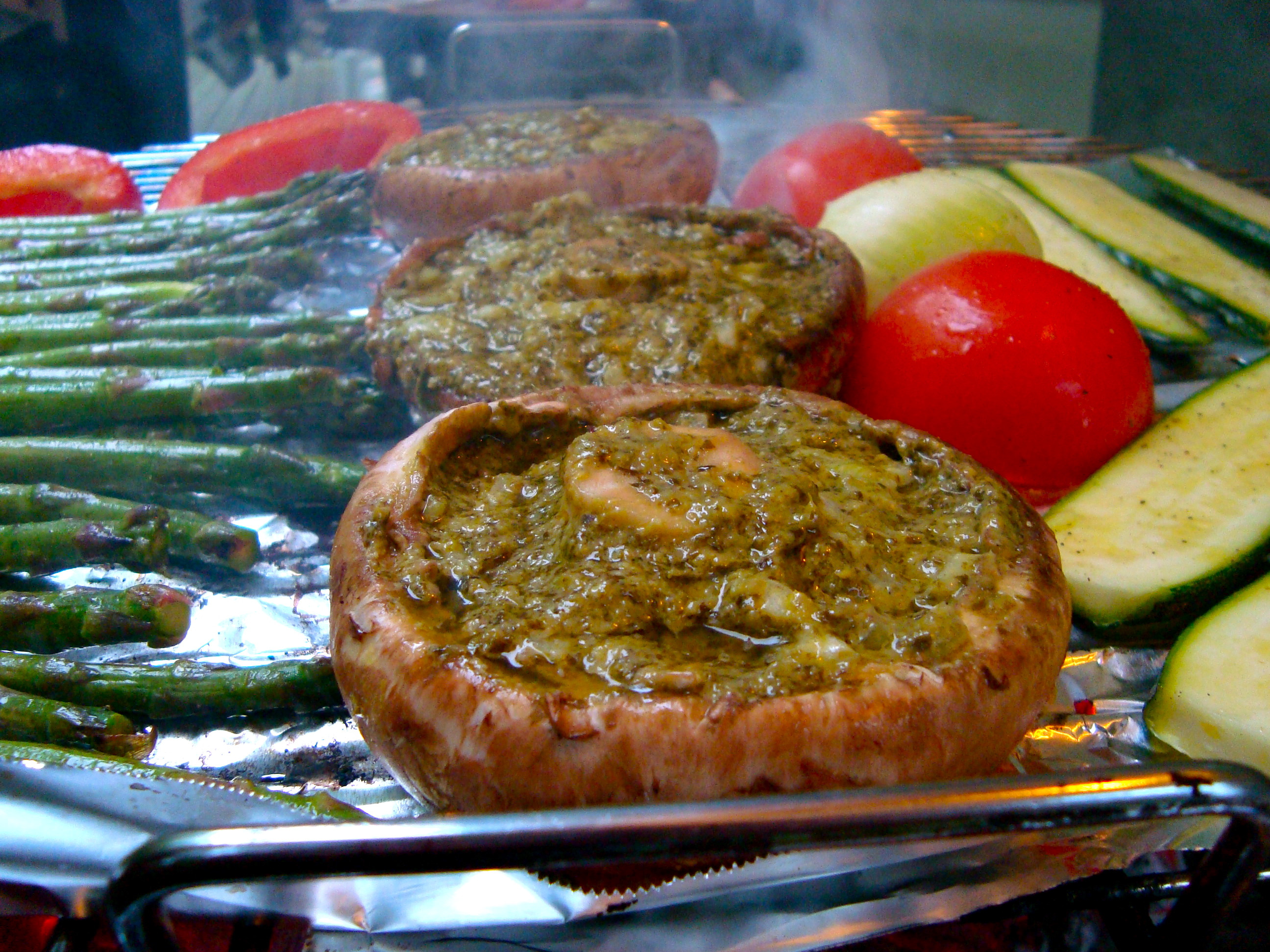 Grilled Stuffed Portobello Mushrooms  Grilled portobello mushrooms stuffed with pesto