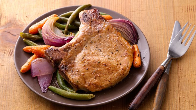 How To Cook Frozen Pork Chops  Oven Roasted Pork Chops and Ve ables recipe from Betty