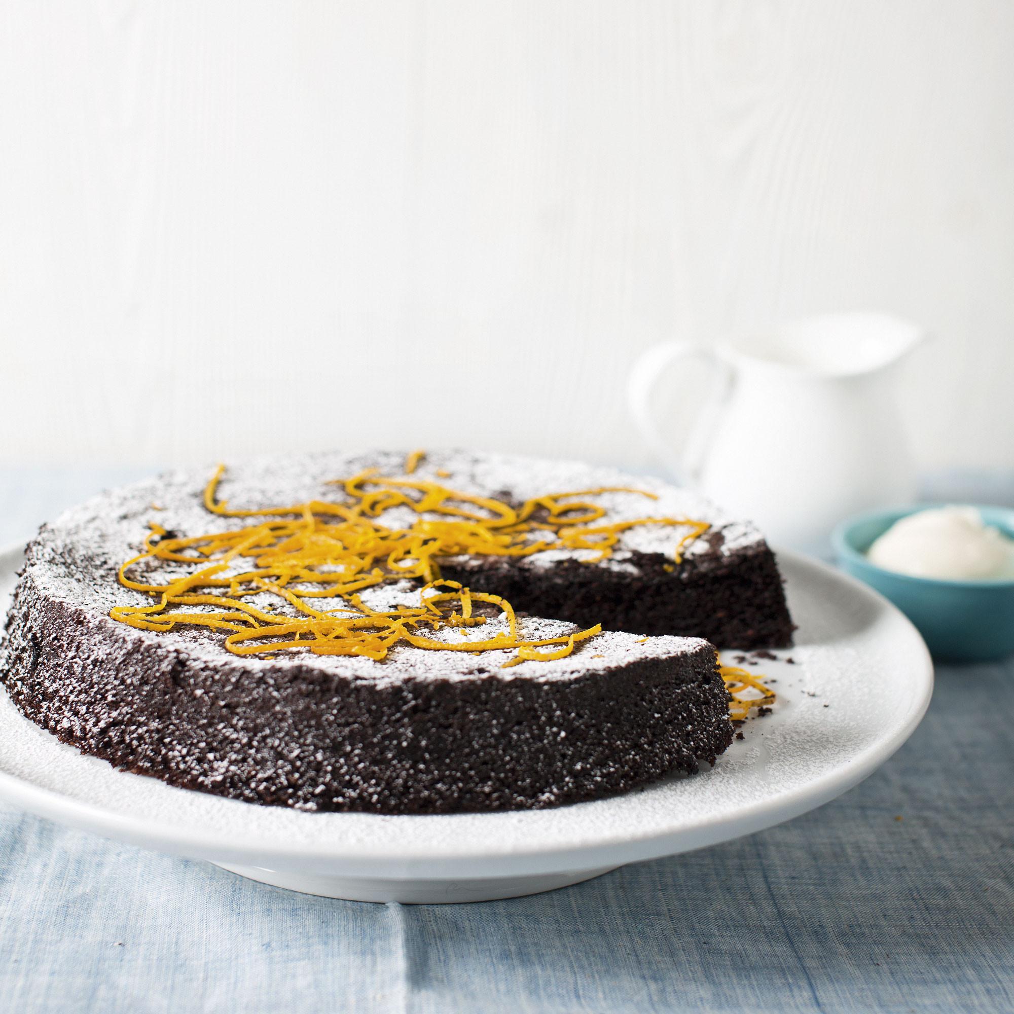 Orange Chocolate Cake  Homemade Pavlova with seasonal berries or fruit and dark