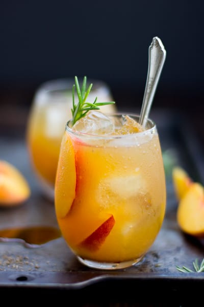 Peach Whiskey Drinks  Rosemary Peach Maple Leaf Cocktail • The Bojon Gourmet