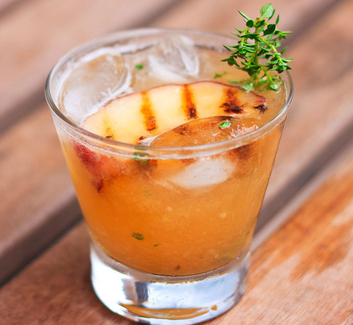 Peach Whiskey Drinks  10 Grilled Fruit Recipes That Will Change Your Summer
