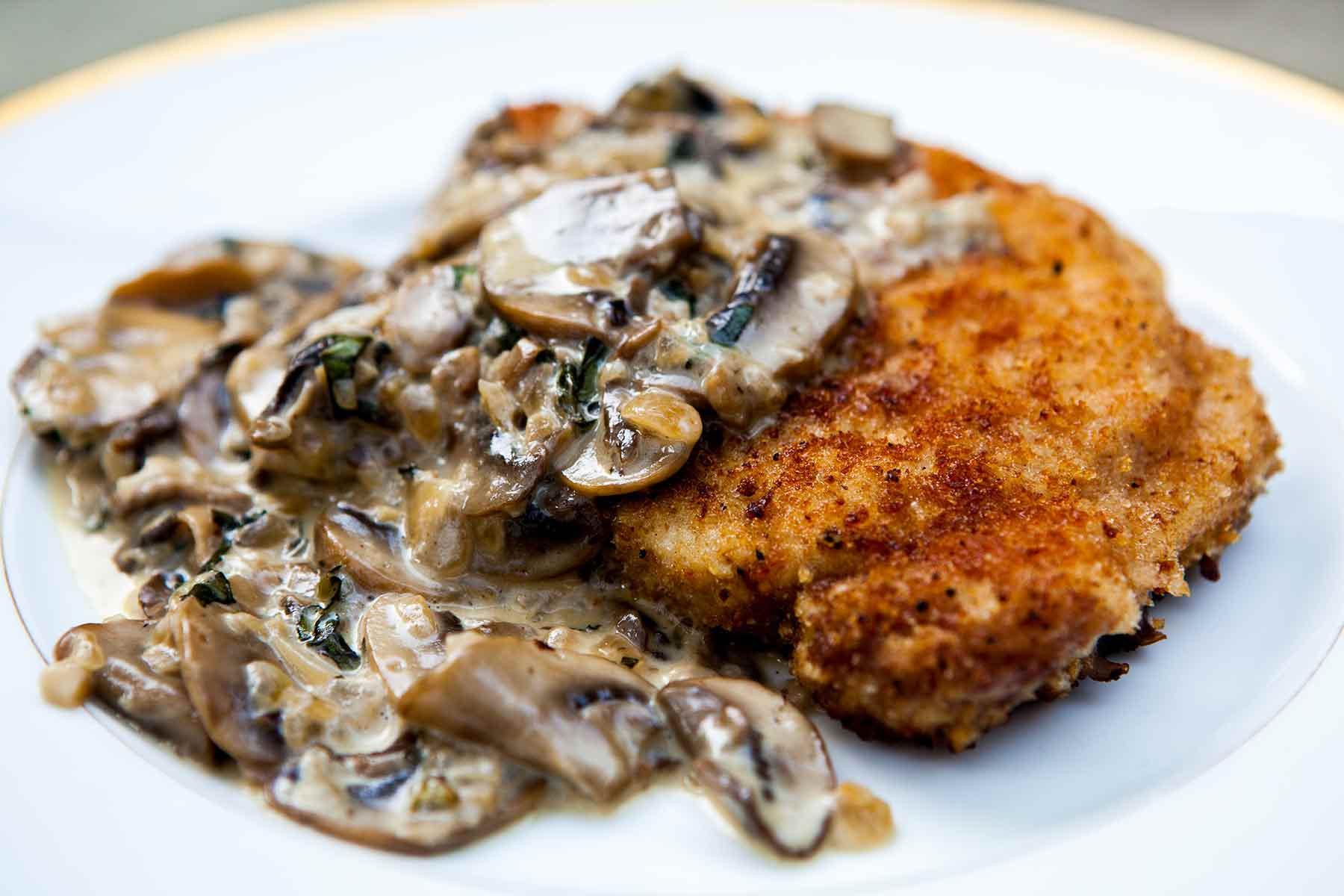 Pork Chops And Mushrooms  Pork Chops with Mushroom Bourbon Cream Sauce Recipe