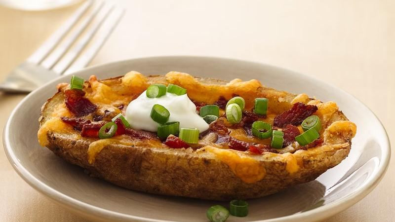 Potato Skin Recipes  Cheesy Bacon Potato Skins recipe from Betty Crocker