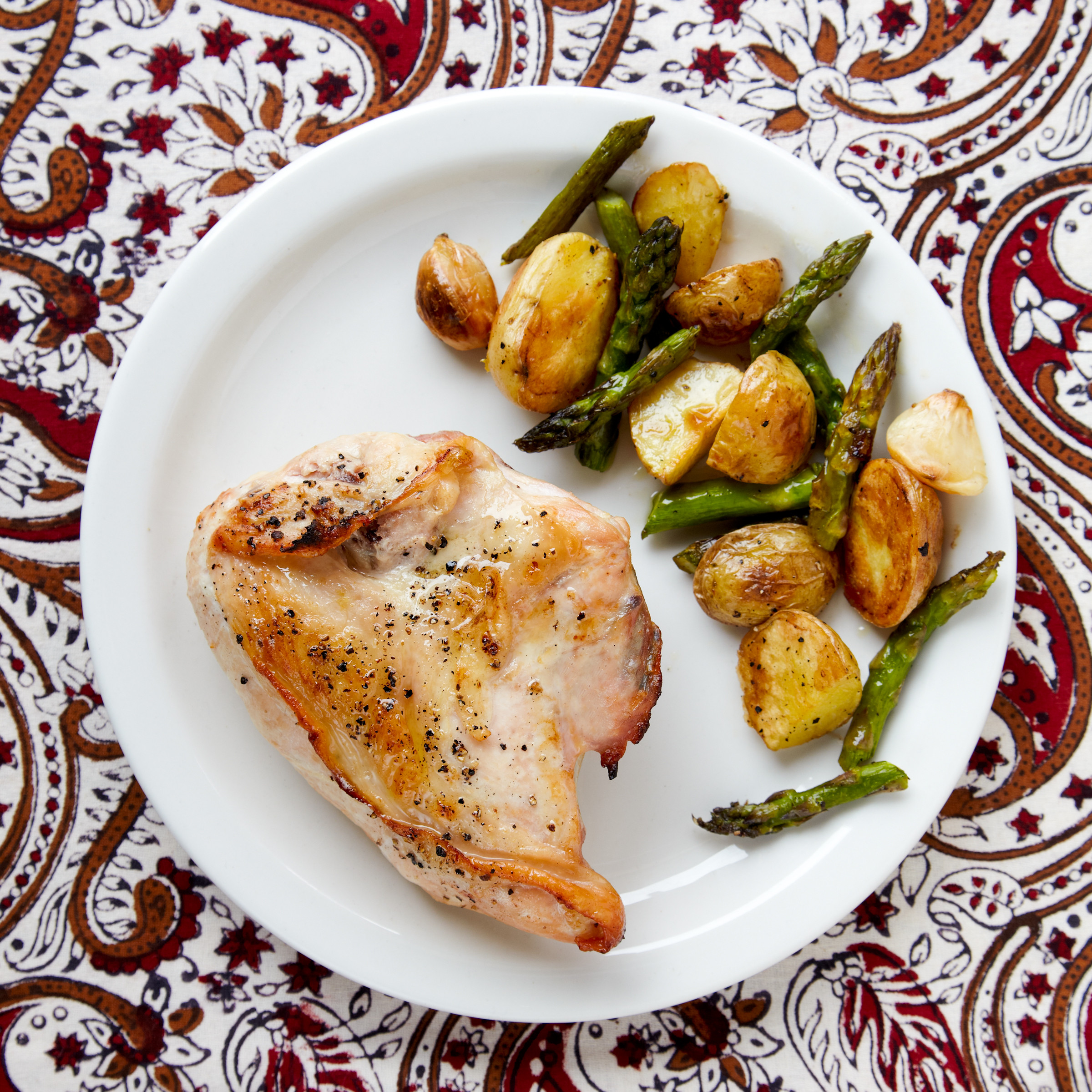 Roasted Chicken And Potatoes  Roasted Chicken New Potatoes and Asparagus Recipe