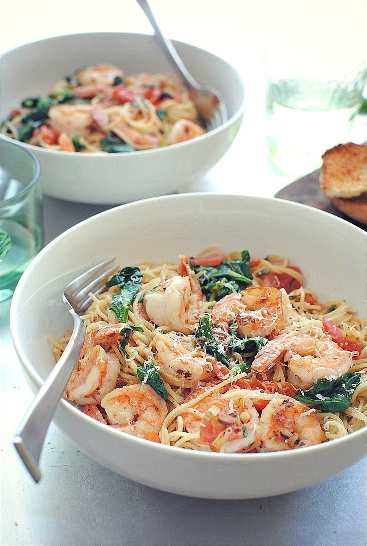 Shrimp And Spinach Pasta  Shrimp Pasta with tomatoes lemons and spinach via