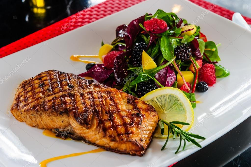 Side Dishes For Salmon  Roasted salmon with berry side dish — Stock