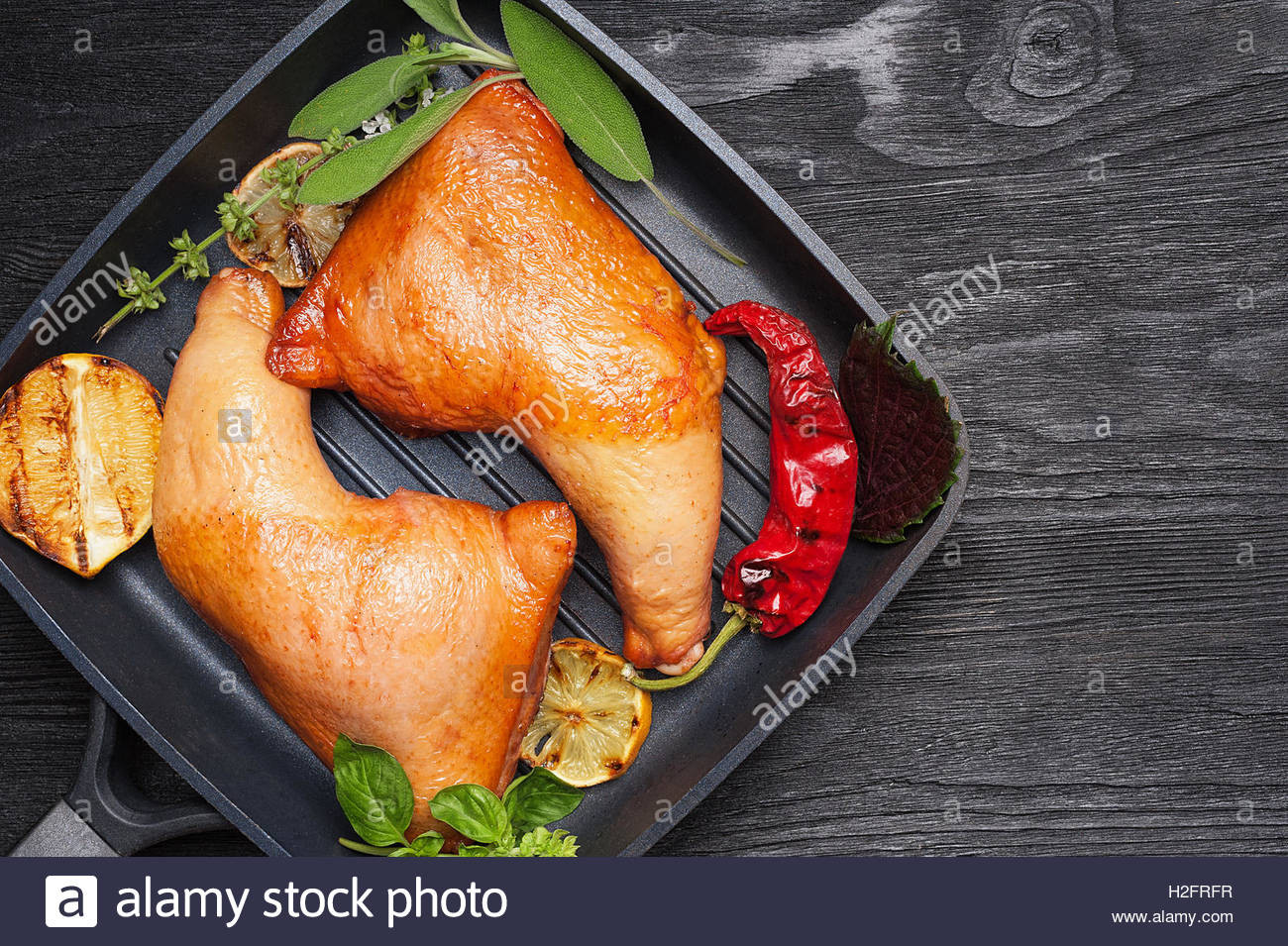 Smoked Chicken Legs  Smoked chicken legs with grilled ve ables top view with