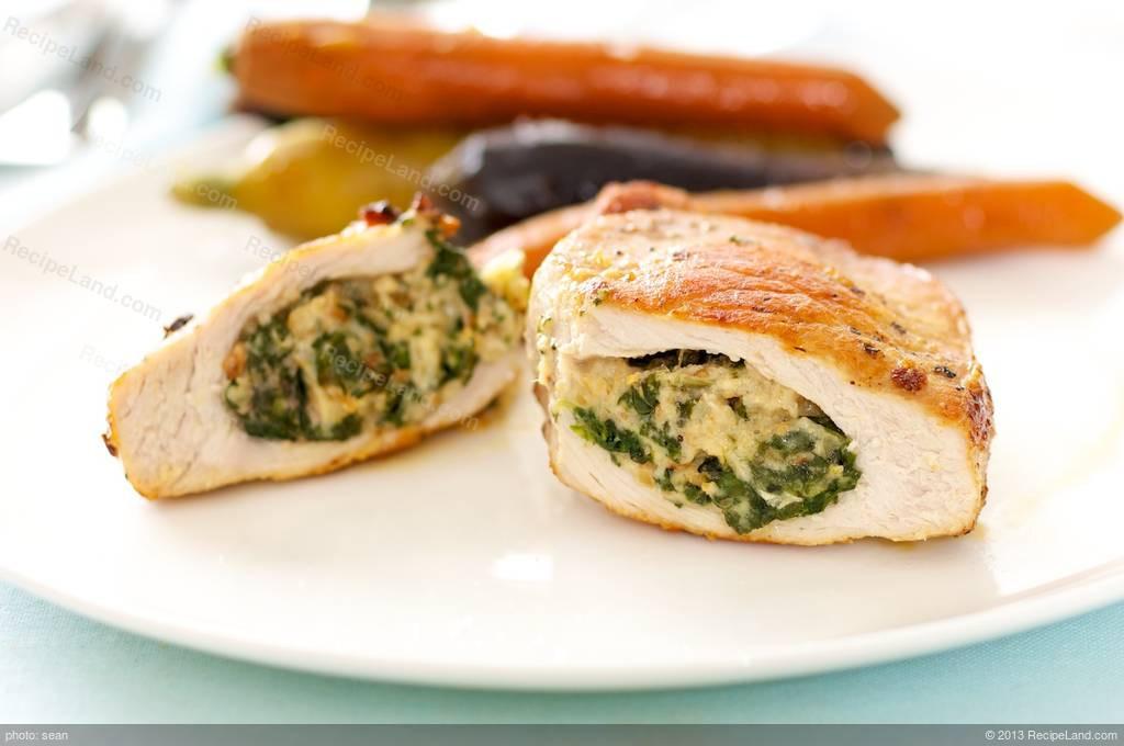 Spinach Stuffed Pork Chops  Spinach Mozzarella and Pine Nuts Stuffed Pork Chops Recipe
