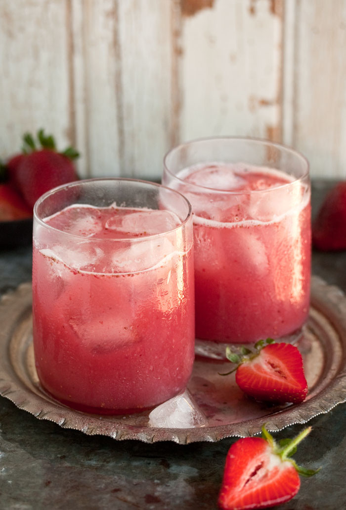 Strawberry Rum Drinks  a delectable cocktail with strawberries and coconut water