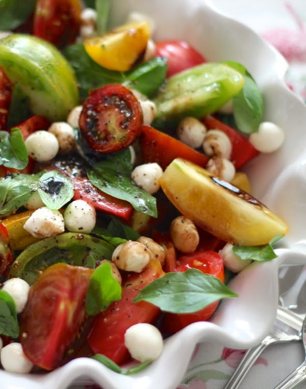 Tomato Caprese Salad  a cup of mascarpone heirloom tomato caprese salad with