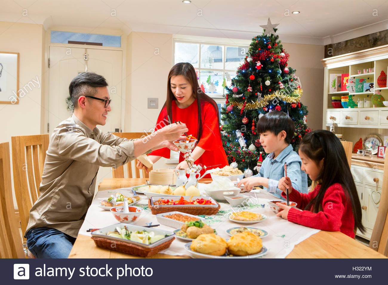 Traditional New Year'S Dinner  Chinese family enjoying their christmas dinner They are