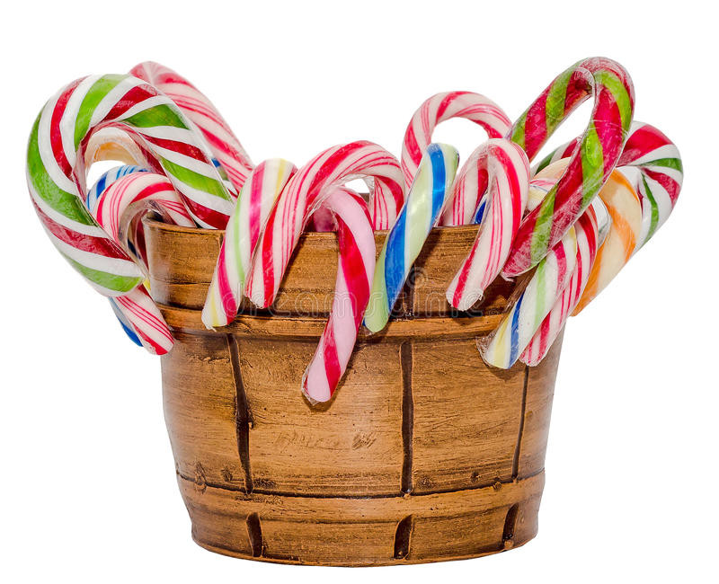 Christmas Candy Sticks  Colored Candy Sticks And Christmas Lollipops In A Brown