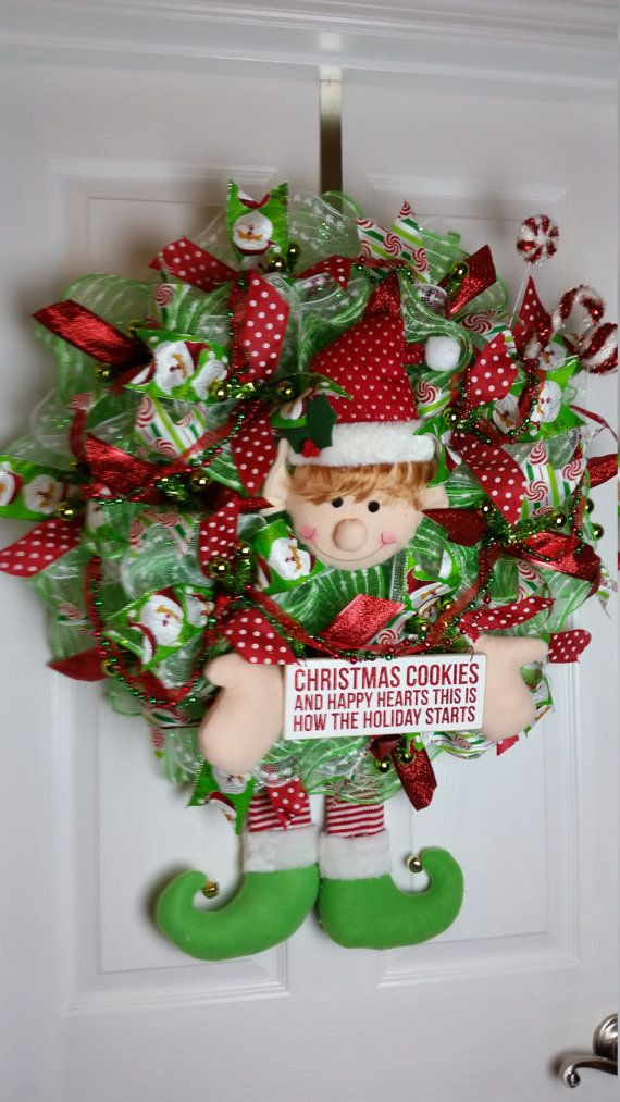 Christmas Cookies And Holiday Hearts  This deco mesh Christmas wreath features an elf with a